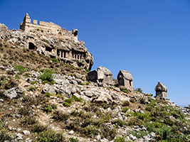 Ruins of Tlos on mountain with Lycian graves